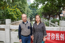 "Local residents Chen Danghui and Li Yuyin tell about how the riverside environment has become transformed and ""very nice"" since the pump gate station was installed nearby."